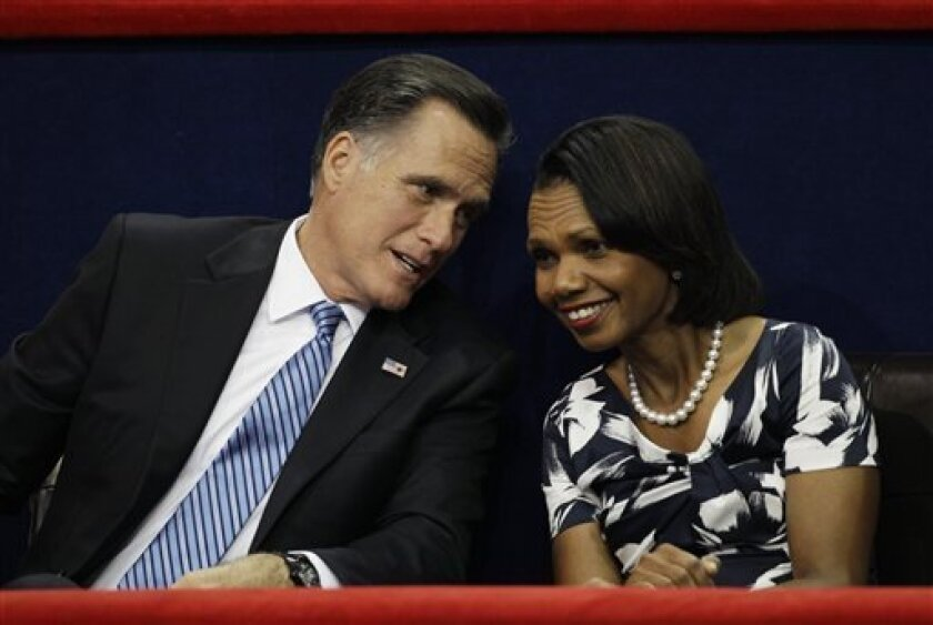 Republican presidential nominee Mitt Romney speaks to Former Secretary of State Condoleezza Rice during the Republican National Convention in Tampa, Fla., on Tuesday, Aug. 28, 2012. (AP Photo/Charlie Neibergall)