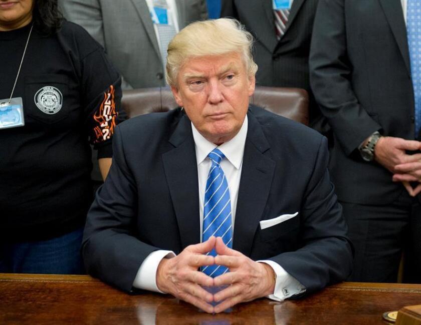 El nuevo presidente, Donald Trump, dimitió la víspera de su investidura de un centenar de cargos empresariales, parte de la Trump Organization, según documentos obtenidos por el canal CNN. EFE/ARCHIVO/POOL