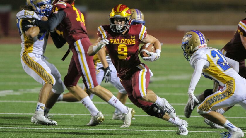 San Pasqual at Torrey Pines- Torrey Pines running back Mac Bingham runs for a first down during one of his many long runs.