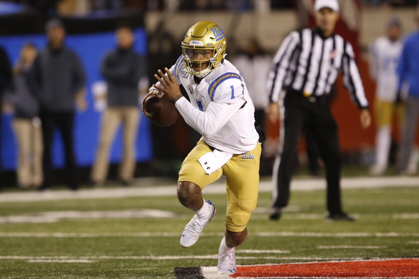 UCLA quarterback Dorian Thompson-Robinson carries the ball against Utah on Saturday in Salt Lake City.