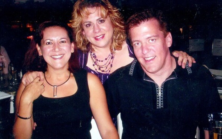 A 2007 photo shows Bruce Pardo, right, with his then-wife Sylvia, left, and a friend at a dinner party. The couple's divorce apparently triggered his rampage.