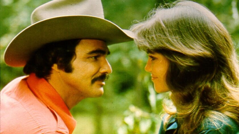 Burt Reynolds, here with Sally Field, developed a mischievous, self-deprecating persona evident in many of today's younger stars.