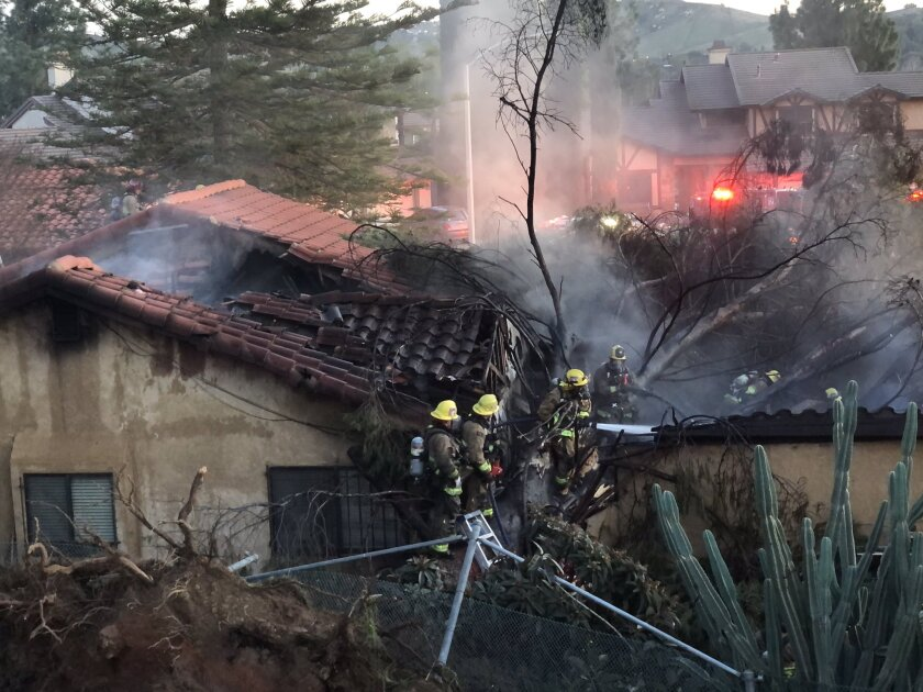 Riverside Fire Department firefighters at house fire