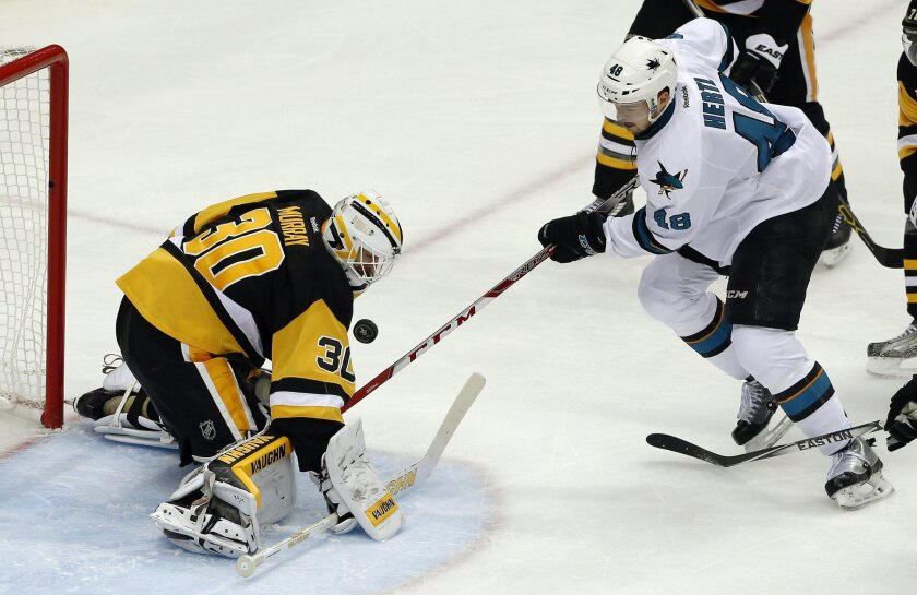 Pittsburgh Penguins goalie Matt Murray (30) stops a shot by San Jose Sharks' Tomas Hertl (48) during the third period in Game 1 of the Stanley Cup final series Monday, May 30, 2016, in Pittsburgh. (AP Photo/Gene J. Puskar)