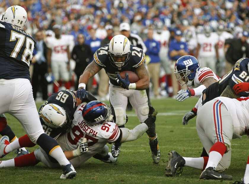 Chargers running back Ryan Mathews fights for yards as the Chargers took on the New York Giants Sunday at Qualcomm Stadium.