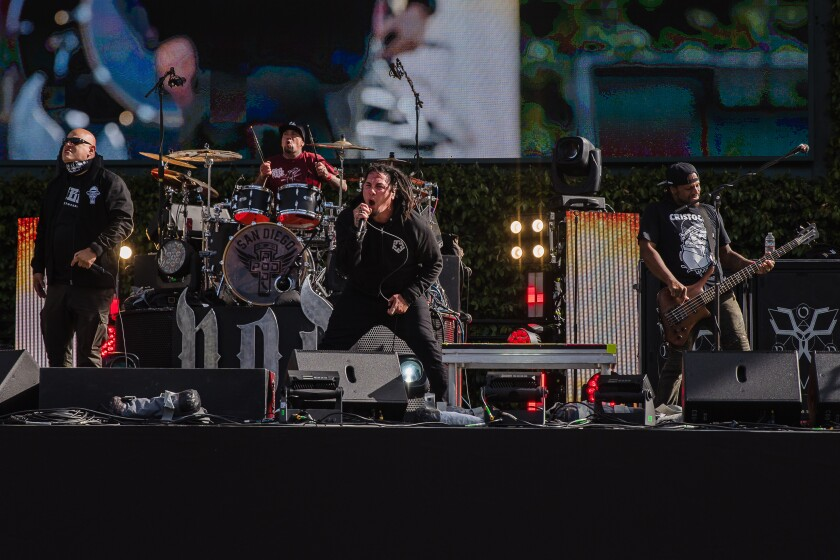 The members of the band P.O.D (Payable on Death) at Petco Park on April 14, 2021.