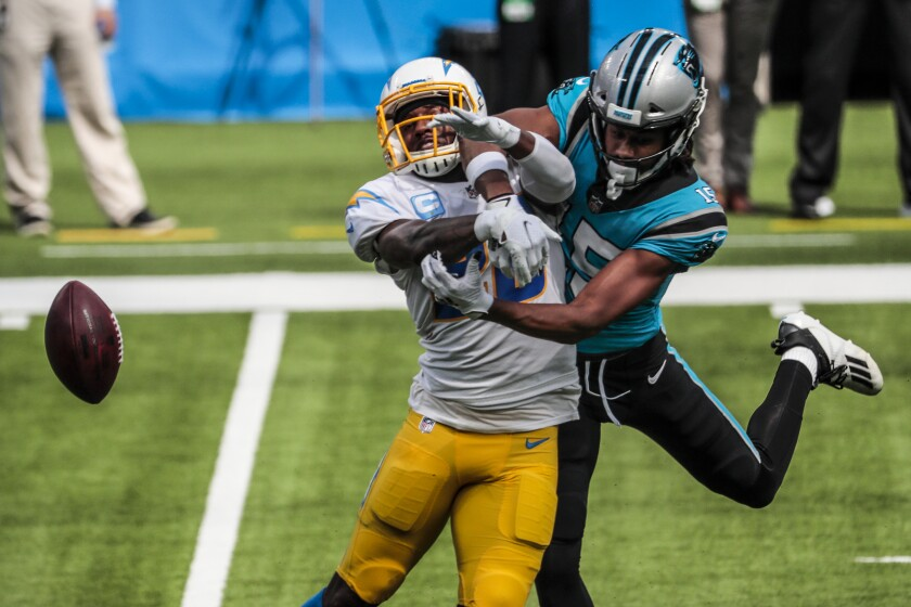 Chargers cornerback Casey Hayward, left, breaks up a pass intended for Carolina Panthers wide receiver Seth Roberts.