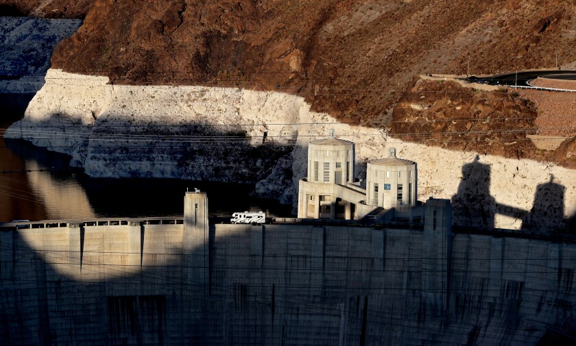 """A white """"bathtub ring"""" behind the Hoover Dam shows the low water level at Lake Mead on June 11."""