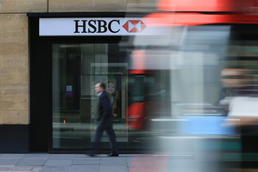 A bus drives past a branch of HSBC near Liverpool Street Station in London, Monday Nov. 2, 2015 as the bank on Monday  announced that their pre-tax profit has jumped by a third in the latest quarter. The bank, Europe's largest by market value, posted $6.1 billion in profit for the July-September pe