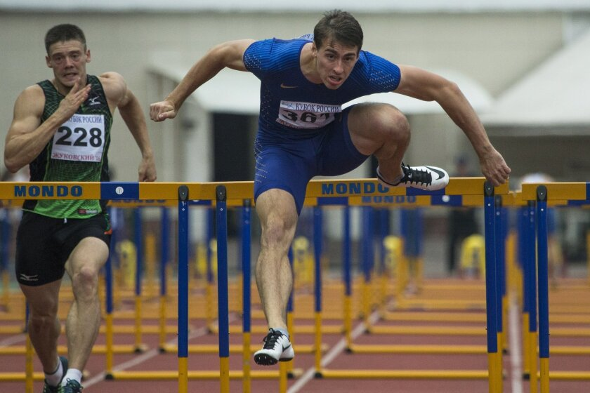 World hurdles champion Sergei Shubenkov competes in the Russian Cup athletics competition in Zhukovsky, near Moscow, Russia, Wednesday, July 20, 2016. A day before a sports court rules on Russia's appeal against the ban on its track and field team from the Olympics, star Russian athletes at a meet