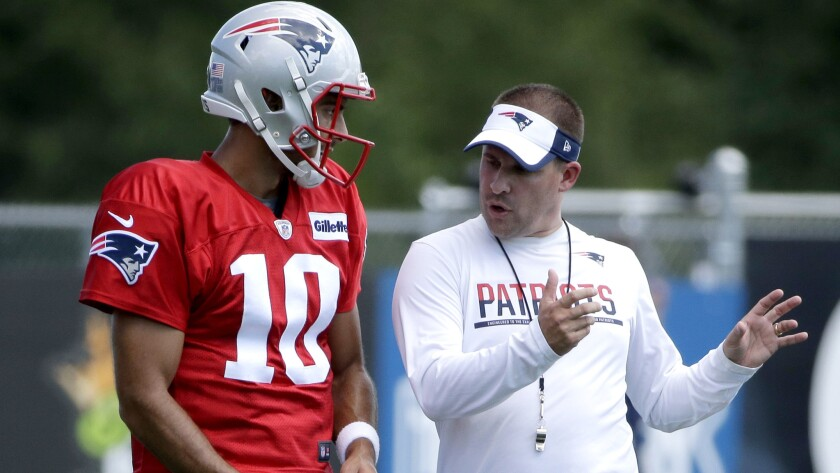Patriots offensive coordinator Josh McDaniels works with backup quarterback Jimmy Garoppolo during a practice earlier this season.