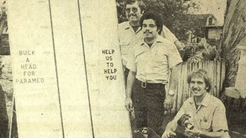 Fire department members stand by a fundraising thermometer in 1976. Current Safety Services Director