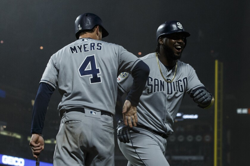 Franmil Reyes is congratulated by Wil Myers after hitting a pinch-hit homer that provided the winning margin in Monday night's 6-5 victory over the Giants. Myers and fellow outfielder Hunter Renfroe also have pinch-hit homers this season.