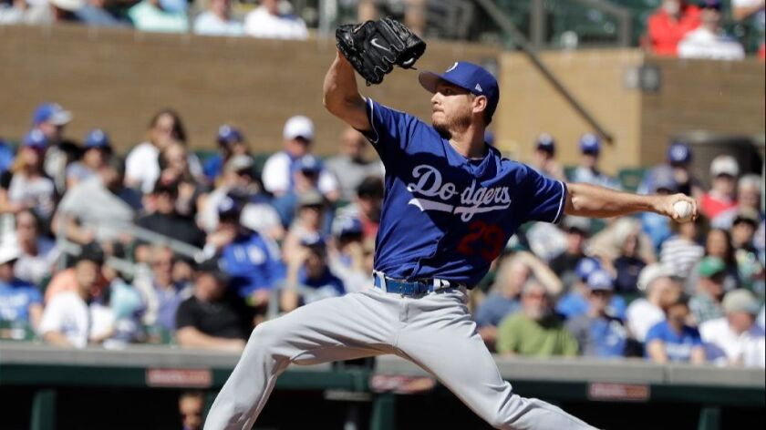Dodgers left-hander Scott Kazmir pitches in the first inning of a game against the Rockies in spring training on March 6.