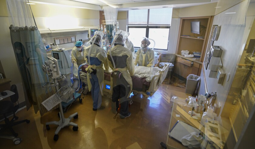 A COVID-19 patient is flipped by the nurses and staff at Sharp Memorial Chula Vista's intensive care unit.