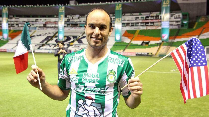 Former U.S. national team star Landon Donovan, shown here when he signed with Mexican club Leon, is asking U.S. fans to root for Mexico in the World Cup.