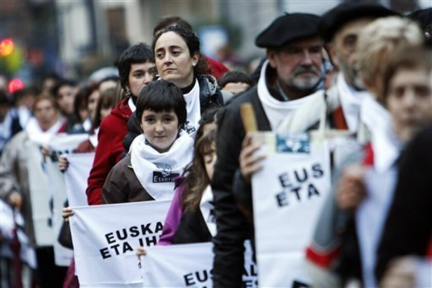 Basque pro-independence supporters march calling for an amnesty that would allow ETA prisoners to serve out the remainder of their sentences in this northern region rather than in jails further afield, during a rally in Bilbao northern Spain, Saturday, Jan. 12, 2013. Spain has for more than two decades dispersed ETA prisoners under an amendment to the country's 1975 anti-terrorism law. There are an estimated 700 ETA prisoners held in jails dotted around Spain and France and only around two dozen believed to be in Basque region goals. (AP Photo/Gaizka Bilbao)