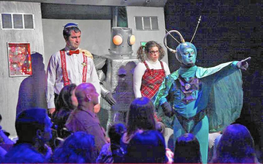 "Jamie Scheel, Joe Sanders, Katie Skinner and Robert Nunez co-star in ""Santa Claus Conquers the Martians"" at Fullerton's Maverick Theater."
