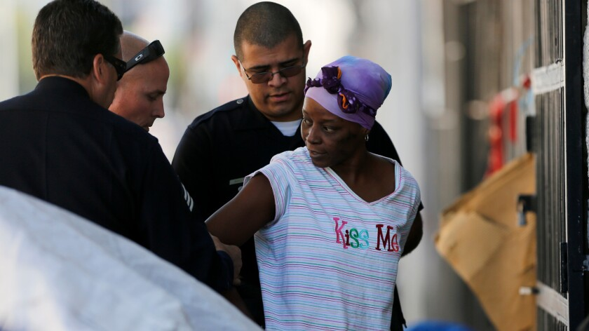 Police make an arrest during a cleanup on skid row in April.