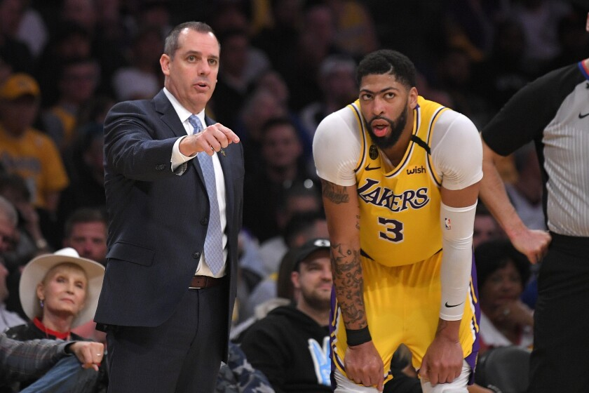 Lakers coach Frank Vogel talks with forward Anthony Davis.