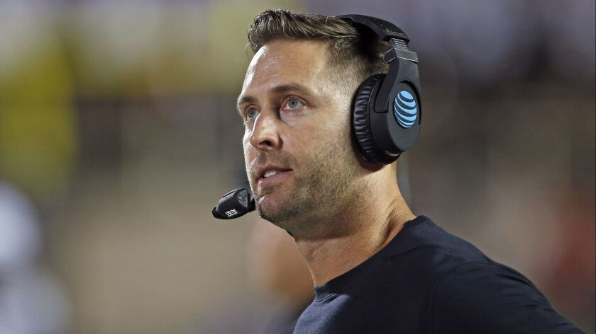 Texas Tech coach Kliff Kingsbury looks at the scoreboard during the team's NCAA college football gam