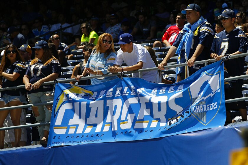 Chargers fans wait at then end of team practice duirng FanFest 2015 to meet the players for autographs.