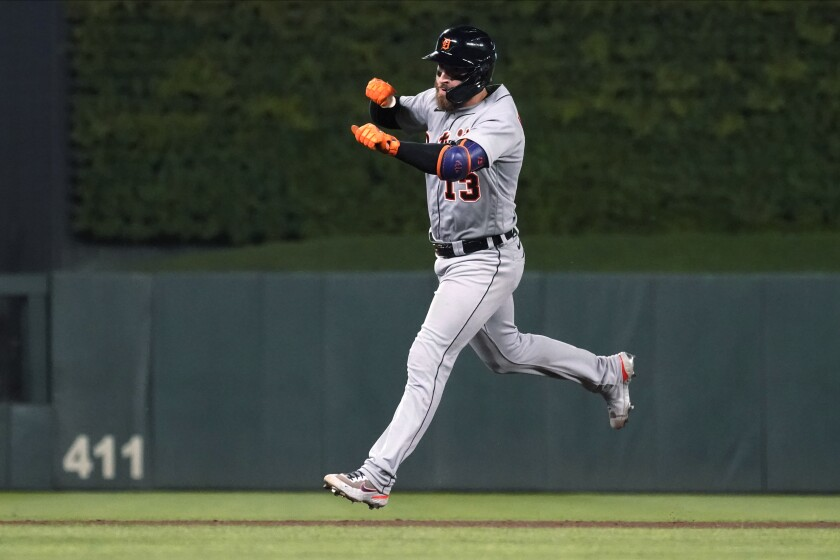 Detroit Tigers' Eric Haase runs the bases on a grand slam off Minnesota Twins pitcher Hansel Robles during the ninth inning of a baseball game Tuesday, July 27, 2021, in Minneapolis. The Tigers won 6-5 in 11 innings. (AP Photo/Jim Mone)