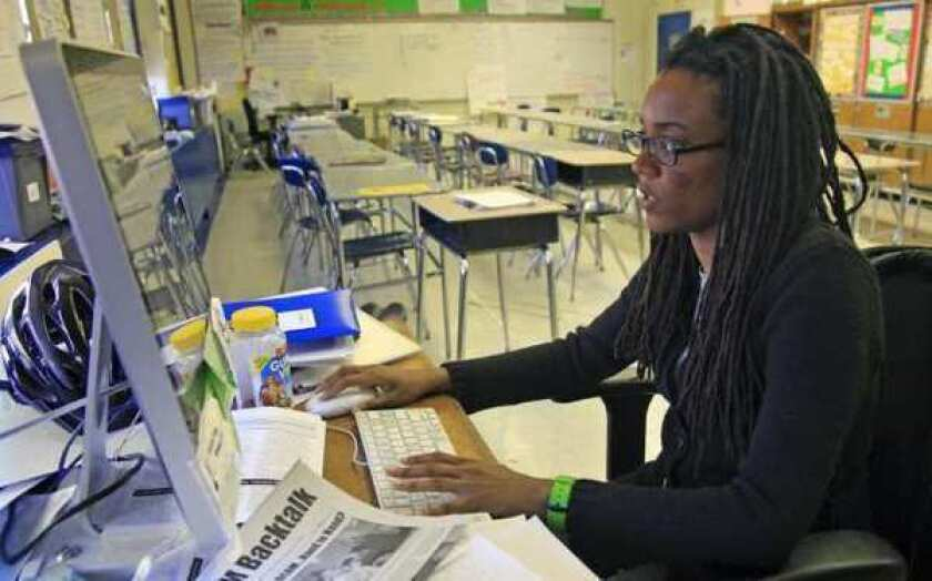 Nkomo Morris, a teacher at Brooklyn's Art and Media High School, works on her classroom computer last month in New York. Morris, who teaches English and journalism, said she has about 50 current and former students as Facebook friends.