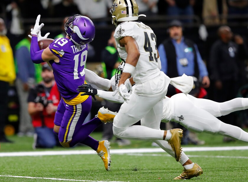 Minnesota Vikings wide receiver Adam Thielen hauls in a 43-yard pass from Kirk Cousins.