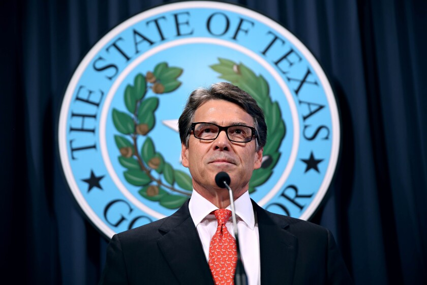 Gov. Rick Perry makes a statement at the capitol building in Austin, Texas concerning the indictment on charges of coercion of a public servant and abuse of his official capacity. Perry is the first Texas governor since 1917 to be indicted.