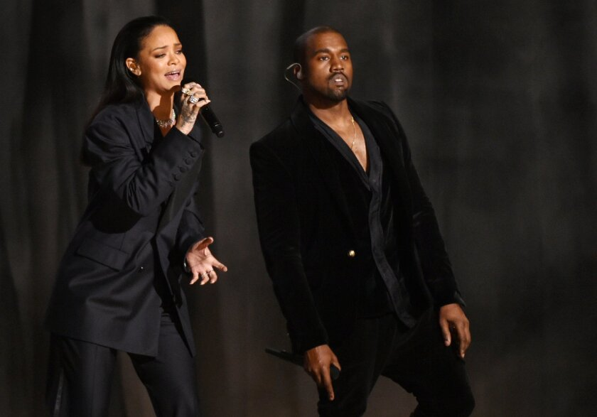 FILE - In this Feb. 8, 2015 file photo, Rihanna, left, and Kanye West perform at the 57th annual Grammy Awards in Los Angeles. West is saying he's sorry to Beck on Twitter. The 37-year-old incendiary hip-hop artist took to Twitter on Thursday, Feb. 26, 2015, to publicly apologize to the 44-year-old musician who won four trophies at the 57th annual Grammy Awards earlier this month. (Photo by John Shearer/Invision/AP, File)