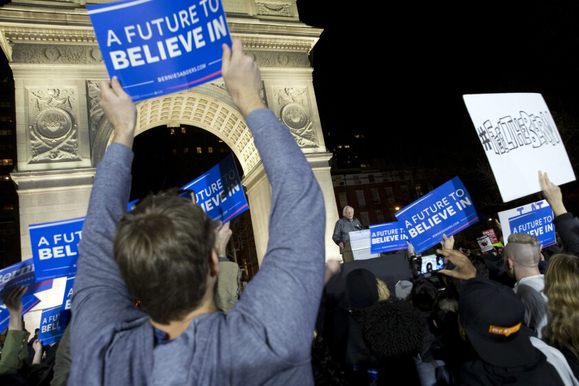 Supporters cheer as Democratic presidential candidate Bernie Sanders speaks during a rally Wednesday in New York.