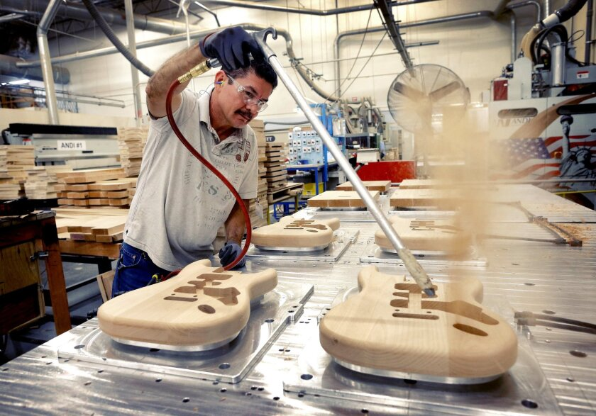 FILE - In this Oct. 14, 2013, file photo, Fender Stratocaster bodies are cleaned out after being cut down by Manuel Espinoza at the Fender factory in Corona, Calif. The Commerce Department reports on U.S. factory orders in April on Tuesday, June 3, 2014. (AP Photo/Matt York, File)