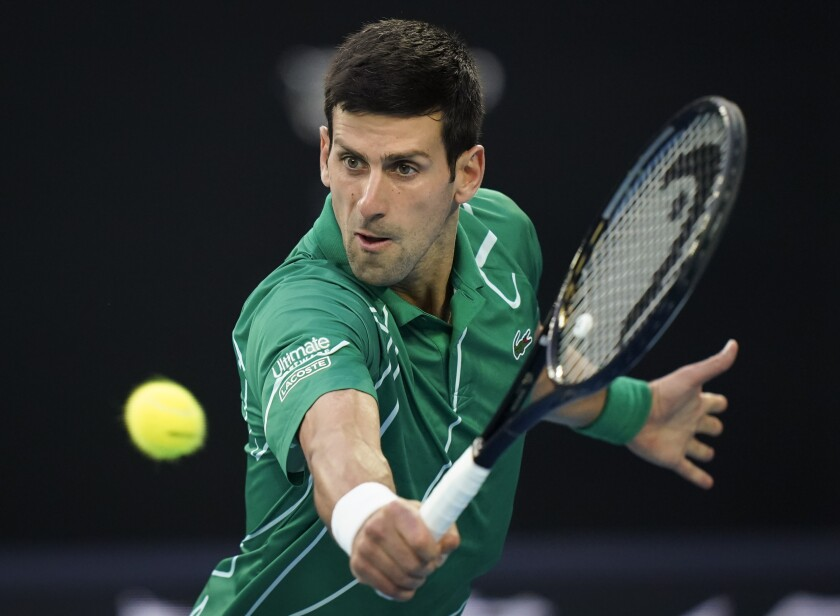 FILE - In this Sunday, Feb. 2, 2020 file photo, Serbia's Novak Djokovic makes a backhand return to Austria's Dominic Thiem during the men's singles final at the Australian Open tennis championship in Melbourne, Australia. No. 1 Novak Djokovic – An eight-time Australian Open champion, including in 2019 and 2020. (AP Photo/Lee Jin-man, File)