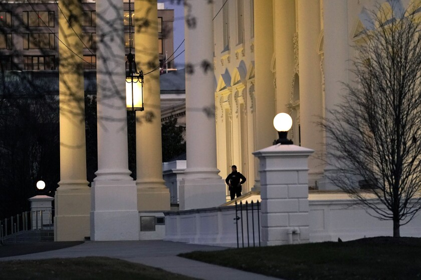 A U.S. Secret Service guard stands post at the North Portico of the White House, after the U.S. House impeached President Donald Trump in Washington, Wednesday, Jan. 13, 2021. (AP Photo/Gerald Herbert )