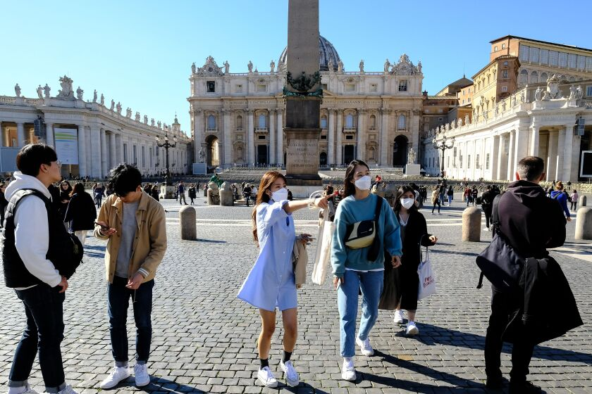 Masked tourists in Vatican City