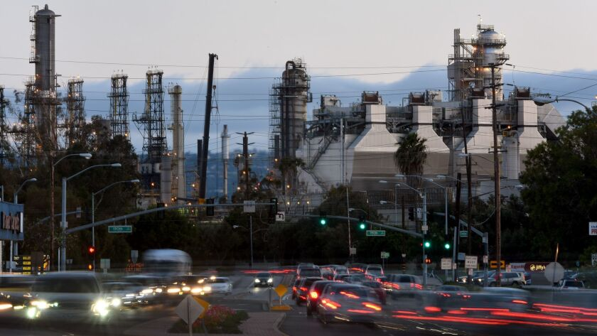 TORRANCE, CA - MAY 9, 2016: Cars drive by the ExxonMobil refinery in Torrance. ExxonMobil planned to