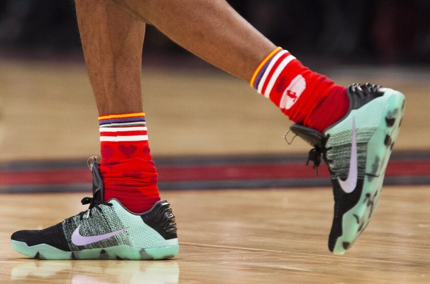The custom shoes of Western Conference's Kobe Bryant, of the Los Angeles Lakers, (24) are shown during the first half of the NBA all-star basketball game, Sunday, Feb. 14, 2016 in Toronto. (Mark Blinch/The Canadian Press via AP) MANDATORY CREDIT