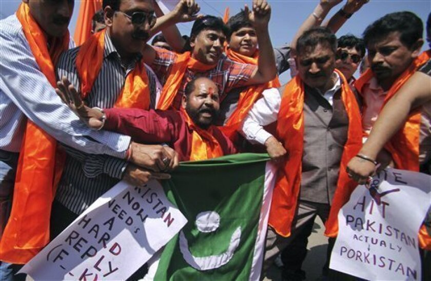 Activists of India's right-wing Shiv Sena party shout anti-Pakistan slogans during a protest in Jammu, India, Friday, March 15, 2013. The protest was against Pakistan's Parliament for passing a resolution condemning the hanging of a Kashmiri man Mohammed Afzal Guru and demanded the return of his body to his family. Guru was hanged in New Delhi on Feb. 9 following his conviction in a deadly attack on India's Parliament. (AP Photo/Channi Anand)