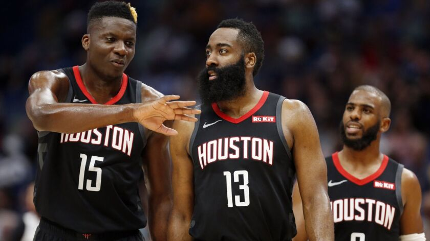 Houston Rockets center Clint Capela (15) Houston Rockets guard James Harden (13) and Houston Rockets