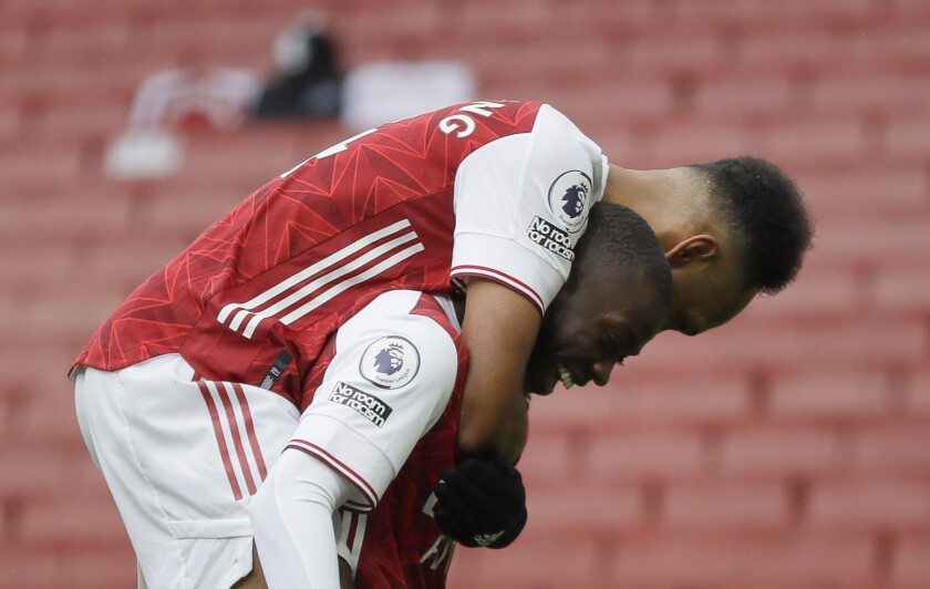 Arsenal's Nicolas Pepe, right, celebrates with teammate Arsenal's Pierre-Emerick Aubameyang after scoring his sides second goal during the English Premier League soccer match between Arsenal and Sheffield United at the Emirates Stadium in London, Sunday, Oct. 4, 2020. (AP Photo/Kirsty Wigglesworth)