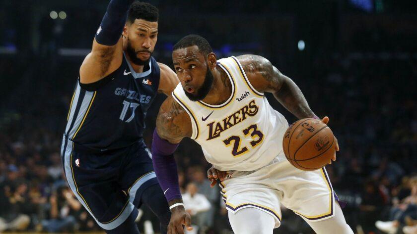 Lakers forward LeBron James drives past Grizzlies guard Garrett Temple during a game earlier this season.