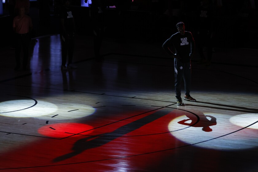 Raptors forward Pascal Siakam awaits player introductions before a playoff game in Orlando, Fla.