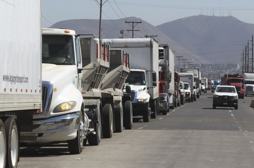 Commercial trucks wait in line to cross at the Otay Mesa Port of Entry on Friday, August 30, 2019 in Tijuana, Mexico.