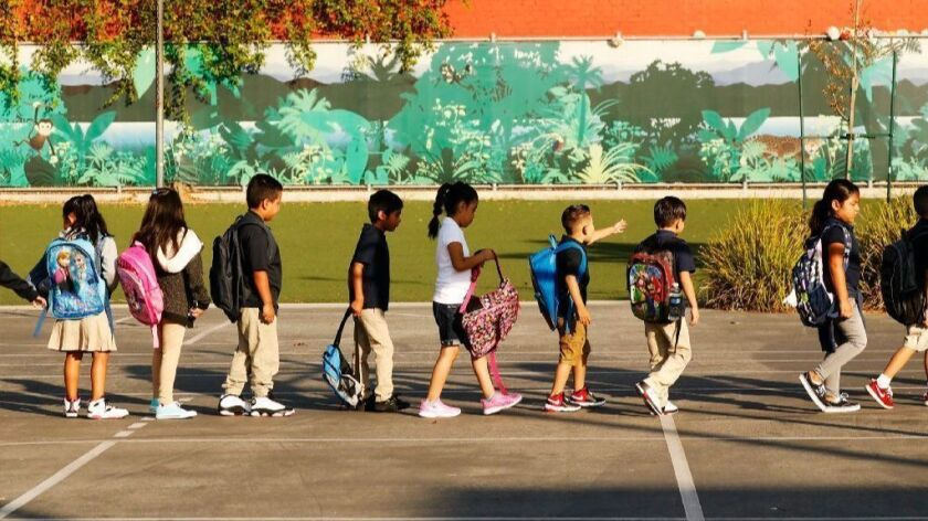 Students form lines on the playground on the first day of school at Dolores Huerta Elementary in Los Angeles.