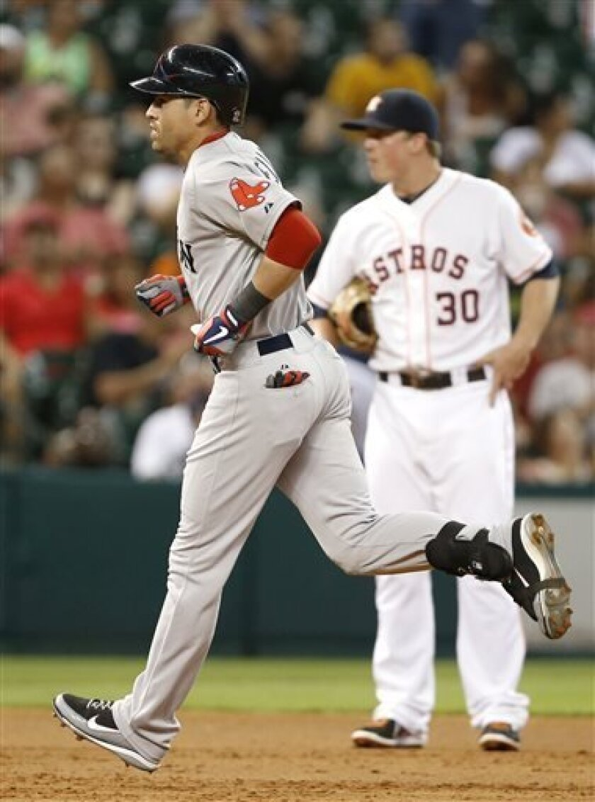 Boston Red Sox's Jacoby Ellsbury rounds the bases in front of Houston Astros third baseman Matt Dominguez (30) after hitting a a two-run home run in the third inning of a baseball game Tuesday, Aug. 6, 2013, in Houston. (AP Photo/Pat Sullivan)