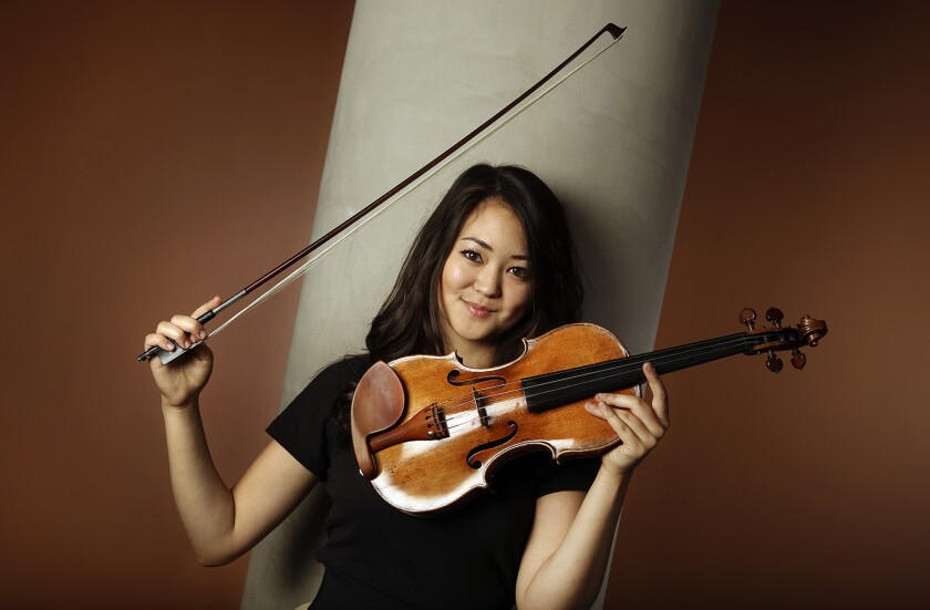 LOS ANGELES, CA-AUGUST 25, 2014: Simone Porter, a 19 year old violin prodigy, who is making her L.A