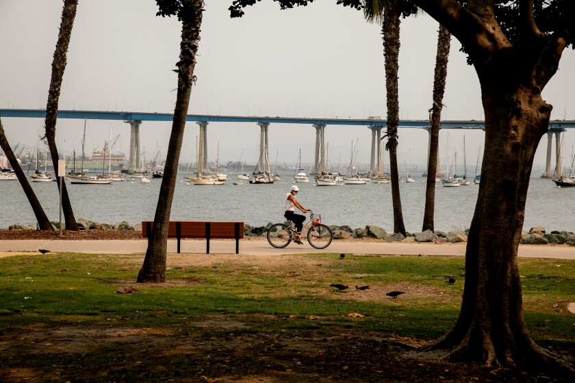 Andy Hanshaw, executive director San Diego Bicycle Coalition, rides along the Bayshore Bikeway in Chula Vista.