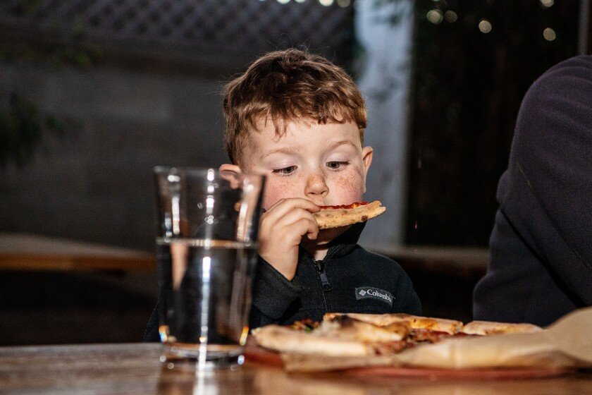 Elliott Woodruff enjoys his pizza during a visit to Piencone Pizzeria Creamery & Pub in Eagle Rock.