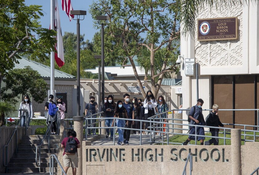 Students walking on campus at Irvine High School.